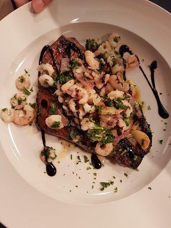 Rump Steak with pan fried garlic prawns