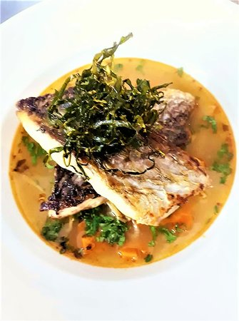 fresh brown meagre in a thai broth