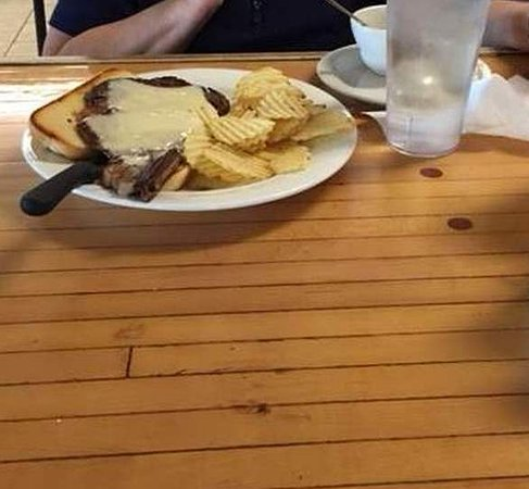Kenmare, North Dakota: prime rib sandwich, tabletop is part of a lane from a bowling alley