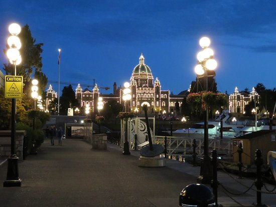 Evening view of Parliament Buildings from the Inner Harbour walkway.