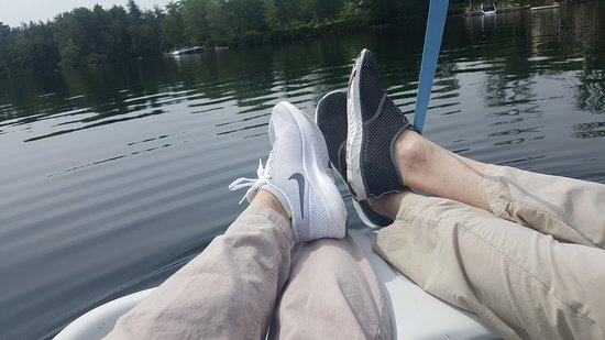 Center Harbor, NH: Relaxing on the paddle boat, listening to book on tape as waves pushed us home