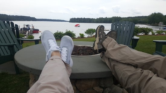 Center Harbor, NH: Daytime relaxing at the fire pit, rain predicted for evening. Relaxing