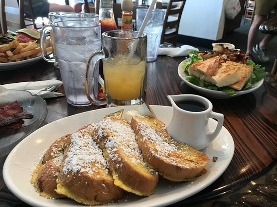 Lighthouse Cafe: french toast with my son's shrimp Caesar salad in the background