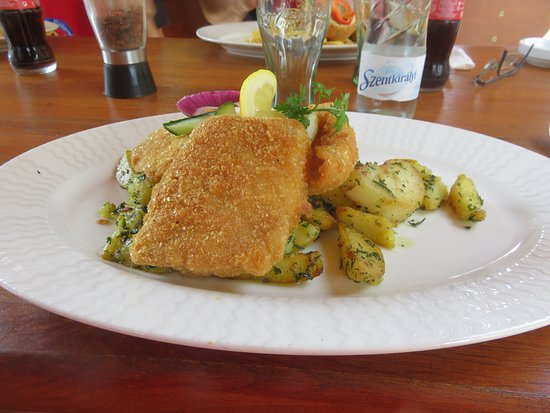 Akaszto, Hungary: Potato flake fried pike perch with parsley potatoes.