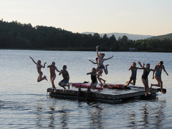 Lyme, NH: Kids jumping from float in the lake