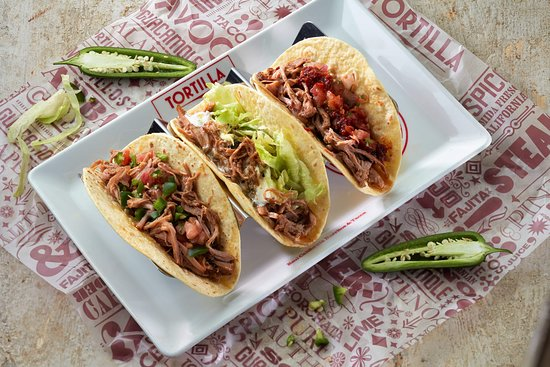 Nottinghamshire, UK: Try a bit of everything with our tasty tres tacos – available in soft shell flour and corn!