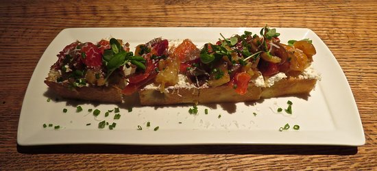 Urbana: Bruschetta: Sheep's​ milk ricotta, roasted pepper, cipolline agrodolce, basil, vin cotto