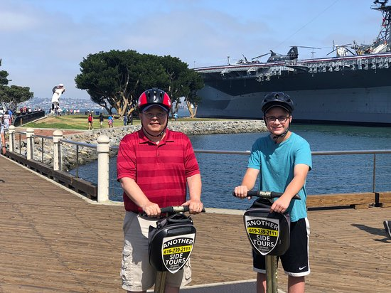 San Diego Early Bird Segway Tour: Posing for a photo in front of the USS Midway