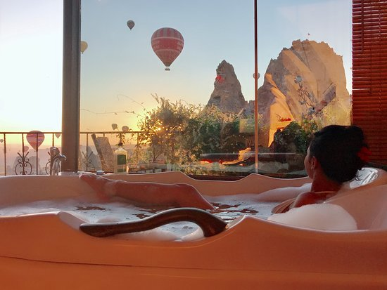 The World's best pool view award 2018 winner. Swim by the Uninesco World Heritage Uchisar Castle.  - Picture of Hermes Cave Hotel, Uchisar - Tripadvisor