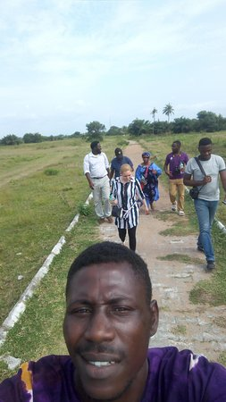 Badagry, Nigeria: Anago Osho Adventures and tourists walking on the slave route
