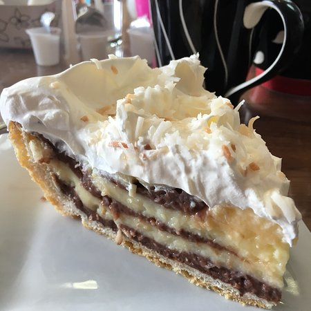 "Vicki's Coldbrook homemade pies are the best! This is ""Macaroon Pie""made up of layers of coconut"
