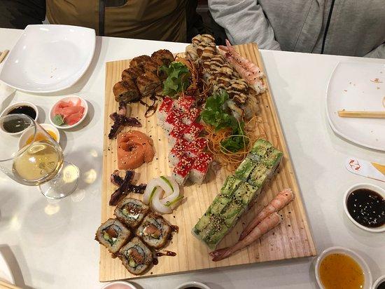 Orimaki Sushi: Four assorted rolls plus two sashimi mixto.
