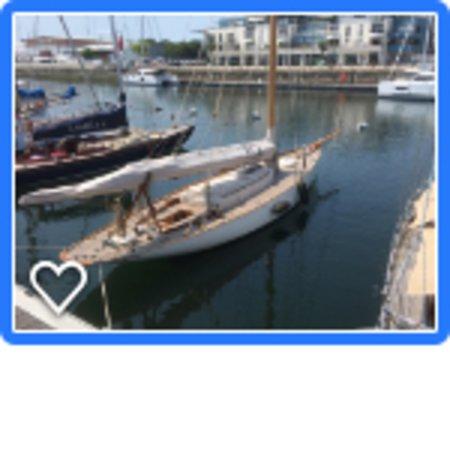 Musée Maritime de La Rochelle: A sleek sailing yacht at the Museum pier