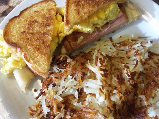 Ham egg cheese sandwich with hash browns
