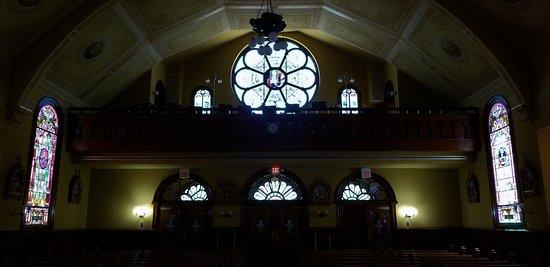 Sacred Heart Catholic Church: Rose stained glass behind choir loft