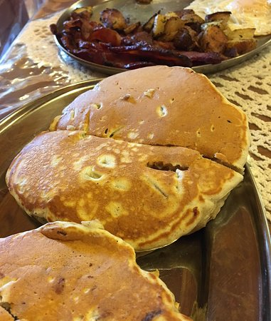 Sanbornton, NH: Chunky monkey pancake (bottom), apple cinnamon, bacon, home fries and eggs.
