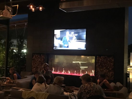 Firepoint Grill Outdoor Patio TV And Fireplace At Night