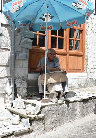Gjirokastra Bazaar: The stone cutter in the Bazaar