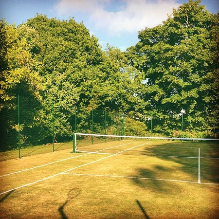 St Hilary, UK: Grass tennis courts on site at Ennys Farm.