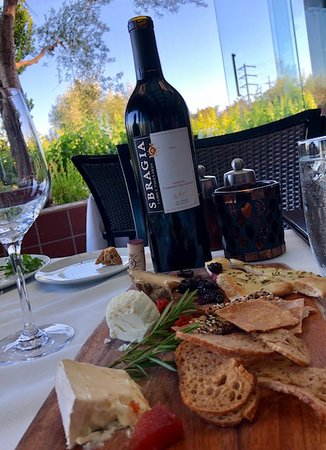 John Ash & Co Restaurant: Cheese plate along side our special wine we brought. All local, all amazingly delicious cheeses.
