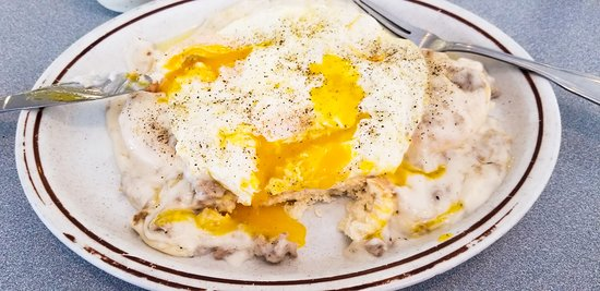 Minonk, IL: Delicious sausage gravy on 2 biscuits topped with 2 over-easy eggs.