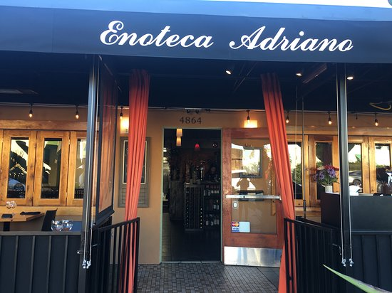 Enoteca Adriano: Indoor and patio seating