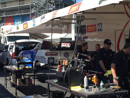 Sonoma Raceway: Preparing car chassis to receive the fiberglass body