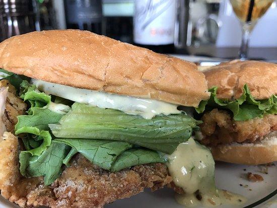 Glendale Springs, NC: Pork tenderloin cutlet sandwich with Swiss, pickled green tomato, lettuce and dijonaisse