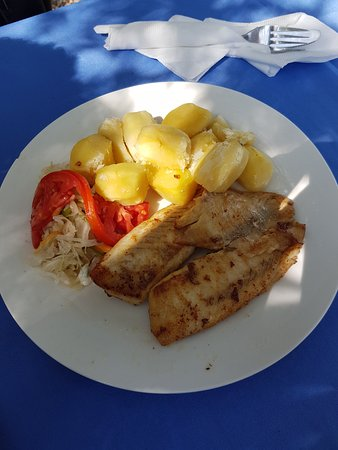 Goretti's Beachside Pizzaria and Grill: Pan fried tilapia with mashed potato and salad - at Goretties Restaurant