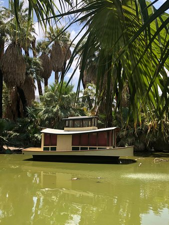 29 Palms Inn: This is the boat at anchor on the pond on the property.