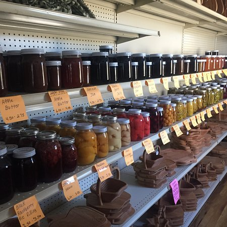Amish Tours of Harmony: Canned goods in an Amish store, buggy and farm in the fall.