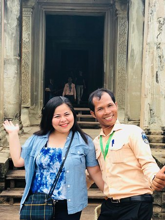 Angkor Full-Day Tour (by Join-In MiniBus): here with our tour guide posing on a photo with me. :)