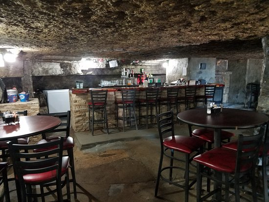Lanagan, MO: This is the inside of the Cave Bar and Grill.  There is a fairly nice bar and several tables.