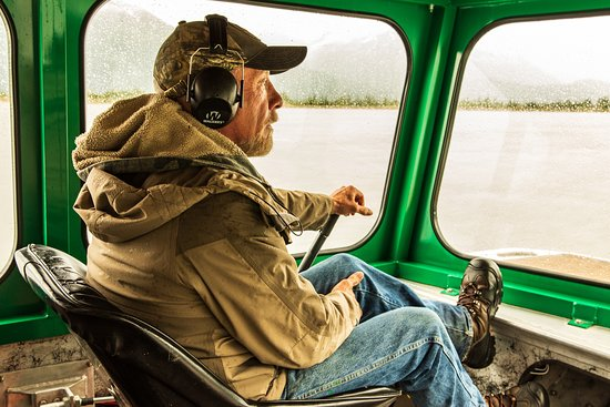 Knik Glacier Tours: the owner piloting an airboat on the glacial lagoon