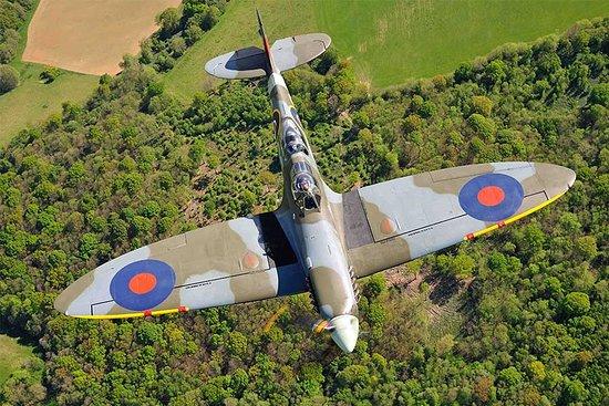 Biggin Hill, UK: Overhead view of 2 Seater Spitfire in flight