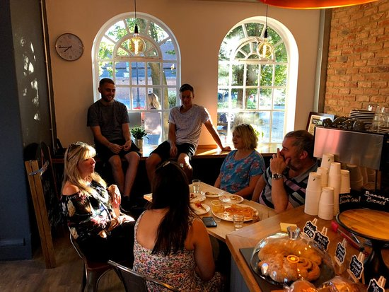 Merstham, UK: People eating pizza at the cafe