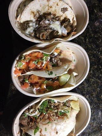 Dank Burrito: Prime Rib Cheesesteak, Jerk Chicken, & Asian Pulled Pork Tacos
