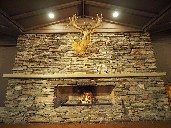 Swiss-Belresort Coronet Peak: Restaurant Fireplace