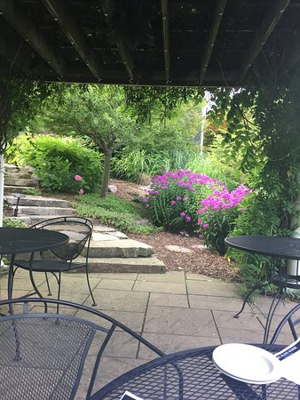 The Blind Horse Restaurant: Patio View To The Garden And Fish Pond