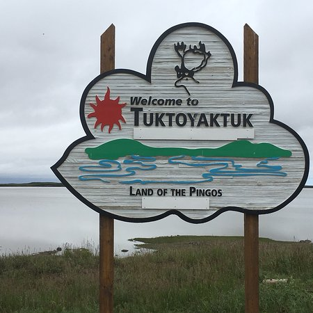 The new town signpost erected after the opening of the new Inuvik to Tuktoyaktuk extension of th