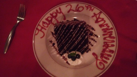 Double Nickel Steak House: Yummy chocolate cake! Our server was so sweet and surprised us with the anniversary message.