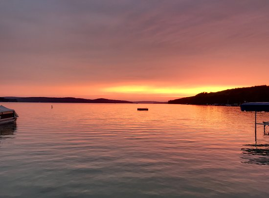 Walloon Lake, MI: Sunset from the beach in front of the hotel.