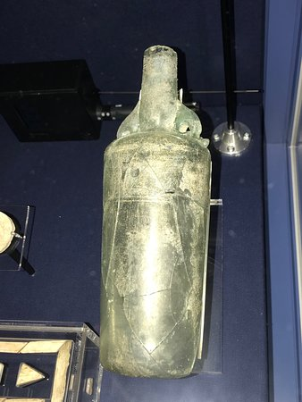 Lullingstone Roman Villa: A glass bottle with dolphin handles from AD 300