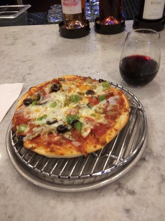 Small (very small) pizza and even smaller glass of wine - Picture of