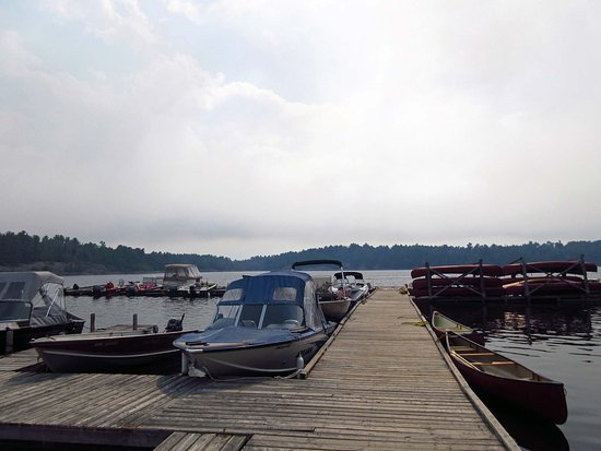 """French River, Canada: The docks and the smoky sky due to the """"Parry Sound 33"""" fire"""