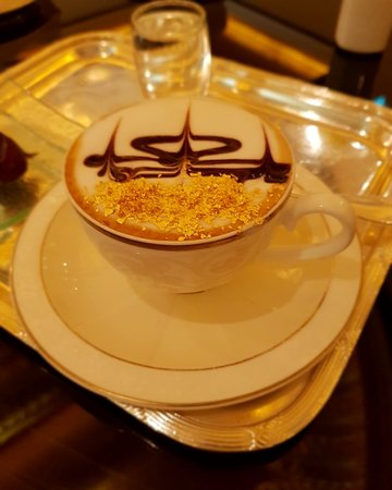 Coffee with gold flakes