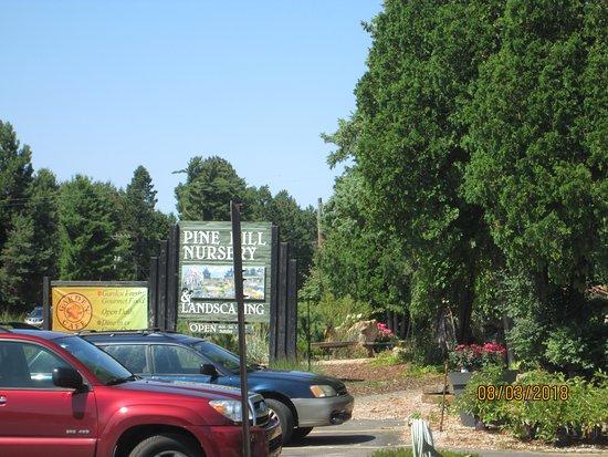Kewadin, MI: sign for cafe in nursery parking lot