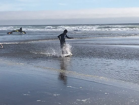 Manzanita Beach: Kids on a bogie board playing in the cold water