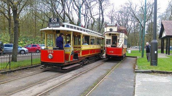 Heaton Park Tramway: 1914 Built Manchester Corporation 765 passes the partial restored 1901 built 173
