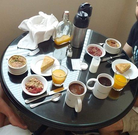Full breakfast: souffle, rhubarb compote, orange polenta cake, coffee, and fresh OJ.